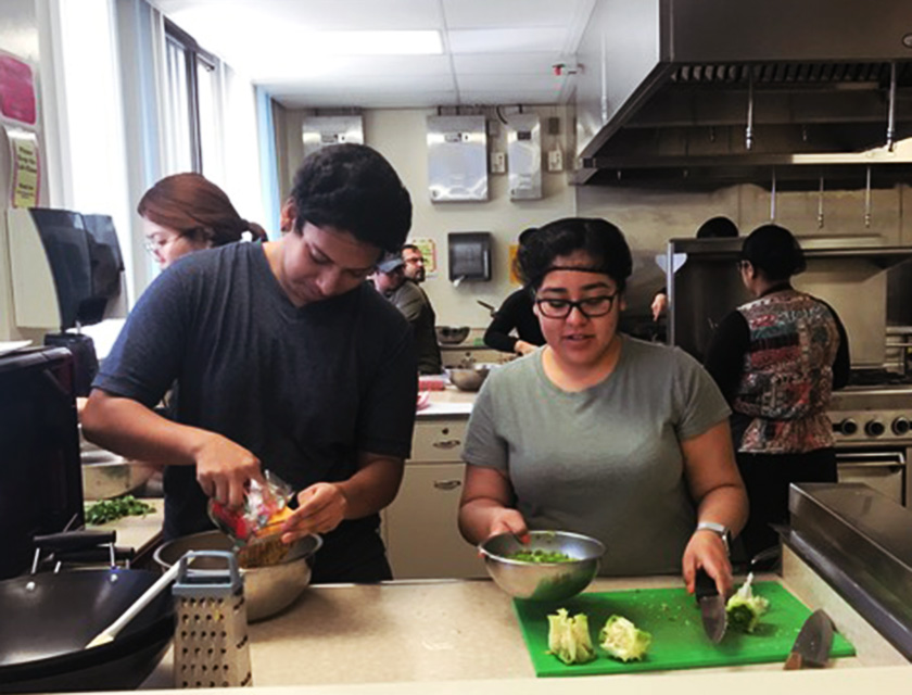 Students prepping food in the lab.
