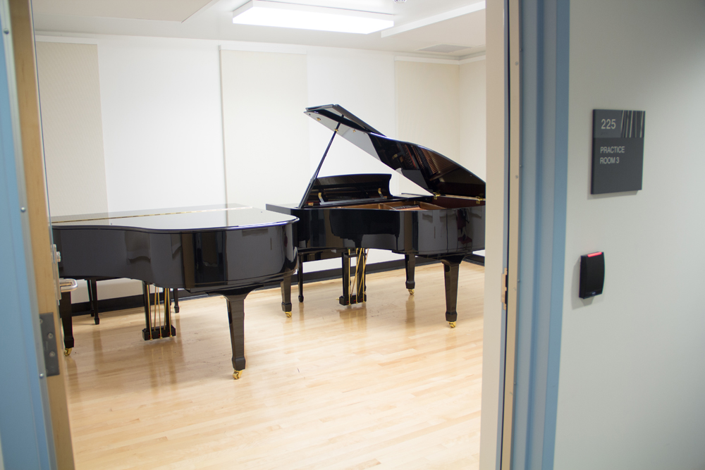 Piano Practice Room with Two Pianos, one open.