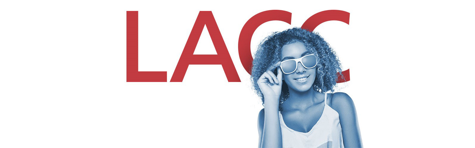 A student in sunglasses stands in front of the LACC logo