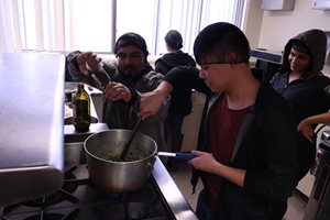 Male students cooking.
